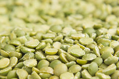Green dry purified peas macro background. Royalty Free Stock Images