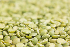 Green dry purified peas macro background. Royalty Free Stock Image