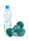 Green dumbbells and a bottle of water Stock Photography