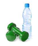 Green dumbbells and a bottle of water Stock Photos