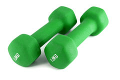 Green dumbbells on an isolated background Royalty Free Stock Image