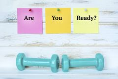 Dumbbells and Are You Ready Notes royalty free stock photography