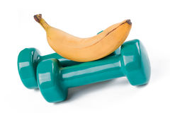 Green dumbell and banana Royalty Free Stock Photography