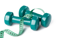 Green dumbell with measuring tape Stock Photos