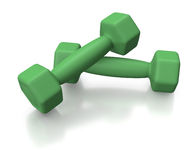 Green dumbells or weights for healthy lifestyle. Green sporty small barbells or weights on white background Royalty Free Stock Images