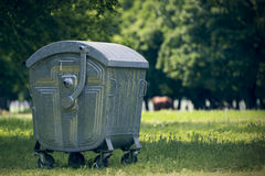 Green dumpster in forest Royalty Free Stock Photography