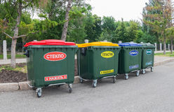 Green dumpsters on a city street Stock Photography