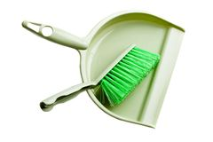 Green dust pan with brush Stock Photo