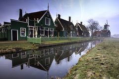Green Dutch Houses. The famous green houses in Zaanse Schans in the Netherlands reflected on the canal in the early morning royalty free stock photos