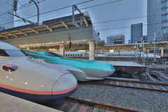 Green E5 series and white E2 series bullet trains Royalty Free Stock Image