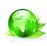 Green Earth. Vector illustration of Green Earth planet (showing Europe and Africa) with leaves and water drops Royalty Free Stock Photography