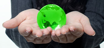 Green earth. Hands holding a green globe.Environmental protection concept Stock Image