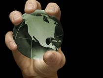 Green Earth. Male hand holding a green globe Stock Images