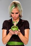 Green Earth. Metaphor with young woman holding the earth with growing plant Royalty Free Stock Image