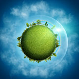 Green Earth. Abstract eco backgrounds over blue skies and clouds Stock Photo