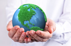 Green earth concept. Hands holding a green earth Royalty Free Stock Photos