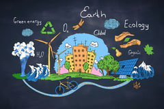 Green earth concept. Creative sketch of natural healthy lifestyle icons on blackboard background. Green earth concept Royalty Free Stock Images
