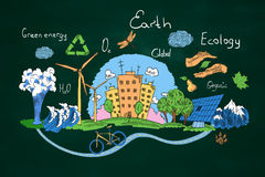 Green earth concept. Creative sketch of natural healthy lifestyle icons on chalkboard background. Green earth concept Royalty Free Stock Photography