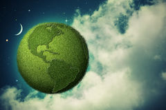 Green Earth flying in the evening skies Royalty Free Stock Photos