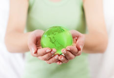 Green Earth Globe in Human Hands Stock Image