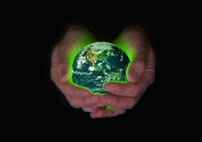 Green earth in safe hands featuring USA. Environmental concept for humanity's responsibility and capacity to care for the planet. Earth image public domain stock photography