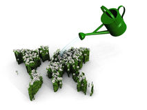 Green earth and watering can Stock Images