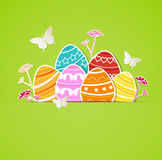 Green Easter background with eggs Stock Photos