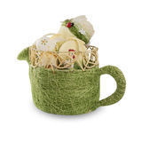 Green Easter basket with colored eggs and a Ladybug  on a white Royalty Free Stock Photos