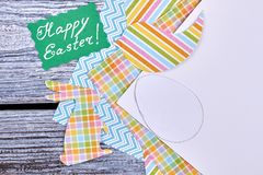 Green Easter card and colorful paper. Stock Image
