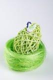 Green Easter Egg in green nest Stock Photo