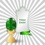 Green easter egg with ornament on a support, a tag with ribbon. Vector Royalty Free Stock Photography