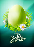 Green Easter Egg poster on blue Royalty Free Stock Photos
