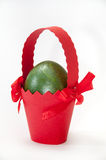 Green easter egg in red carton basket Stock Image