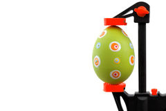 Green Easter egg and vise grip. Easter theme: Green Easter egg and vise grip Royalty Free Stock Photos