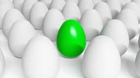 Green Easter egg among white eggs Royalty Free Stock Photos