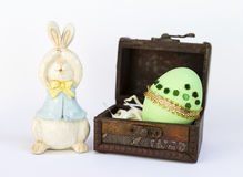 Green Easter egg and wooden bunny Stock Image
