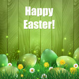 Green Easter eggs with a green wooden background. Royalty Free Stock Images