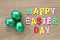 Green of easter eggs on wood background,Handmade painted for des Royalty Free Stock Photos