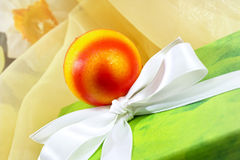 Green easter present with ribbon and easter egg Stock Photo