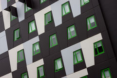 Green Eco Apartments Building. Modern unit design with distinctive green windows stock photography