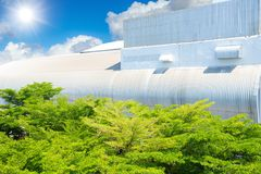 Green Eco factory with tree park garden around building stock photo