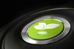 Green eco friendly car button Stock Photo