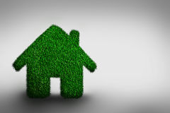 Green, eco friendly house concept. Grassy building on gray. Real estate, architecture and environment Stock Photos