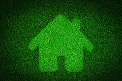 Green, eco friendly house, real estate concept. Overlay on grass background Royalty Free Stock Images
