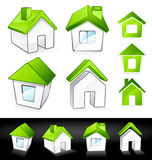Green eco homes. Illustrated set of green eco homes isolated on white and black background Royalty Free Stock Photo