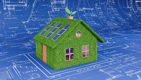 Green eco house on architectural plan. 3D Rendering Stock Photos