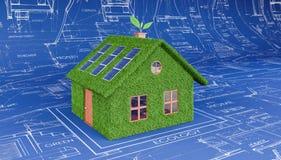 Green eco house on architectural plan Stock Photos