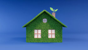 Green eco house on blue background. 3D Rendering Stock Image