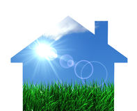 Green Eco House Concept. Ual design with home icon like a window on nature with sun rays, green grass and blue sky Royalty Free Stock Photo