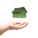 Green Eco house concept  with hand. Isolated on white background Stock Photo